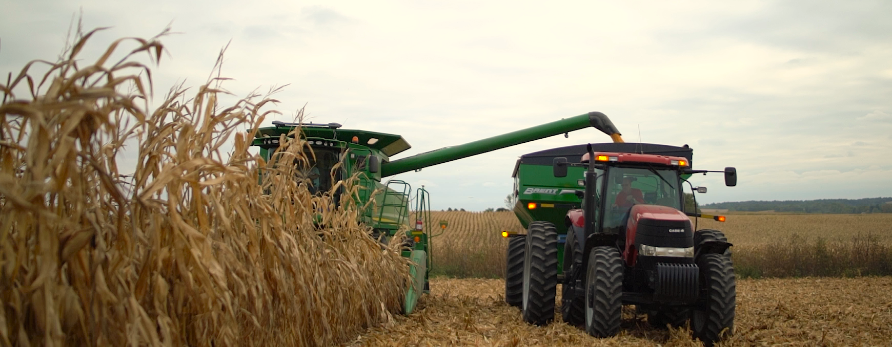 combine and tractor with grain cart